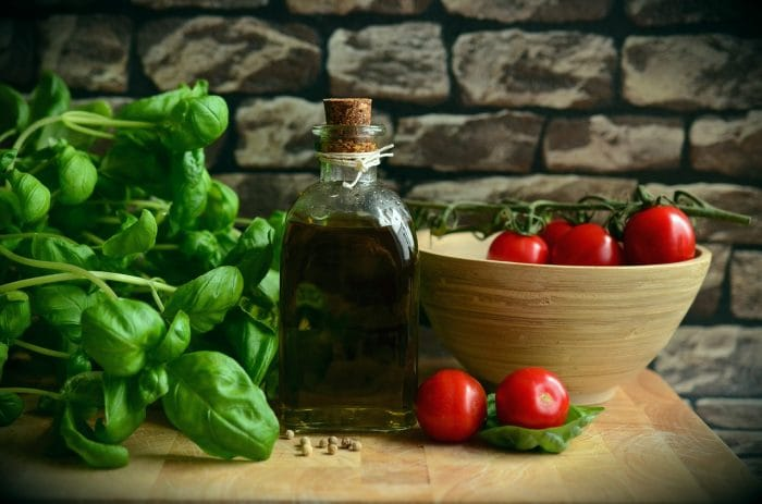 basil, balsamic and tomatoes in a rustic kitchen