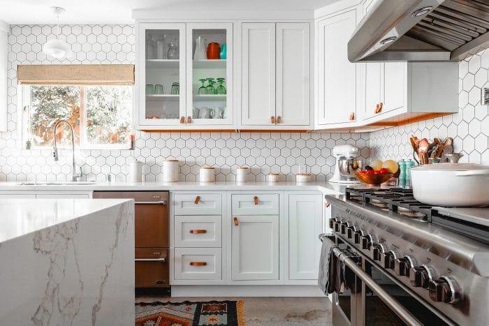 White kitchen with hexagonal splashback