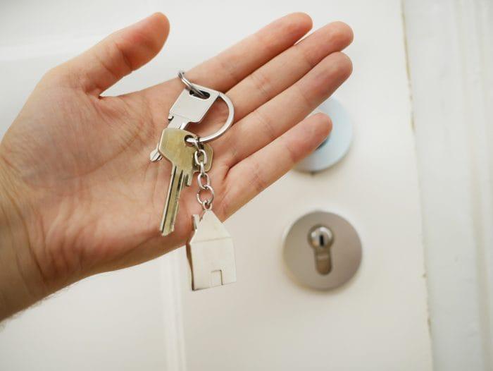 Man holding new home keys