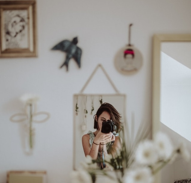 collection of mirror and pictures